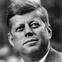 John_F._Kennedy,_White_House_photo_portrait,_looking_up-sq